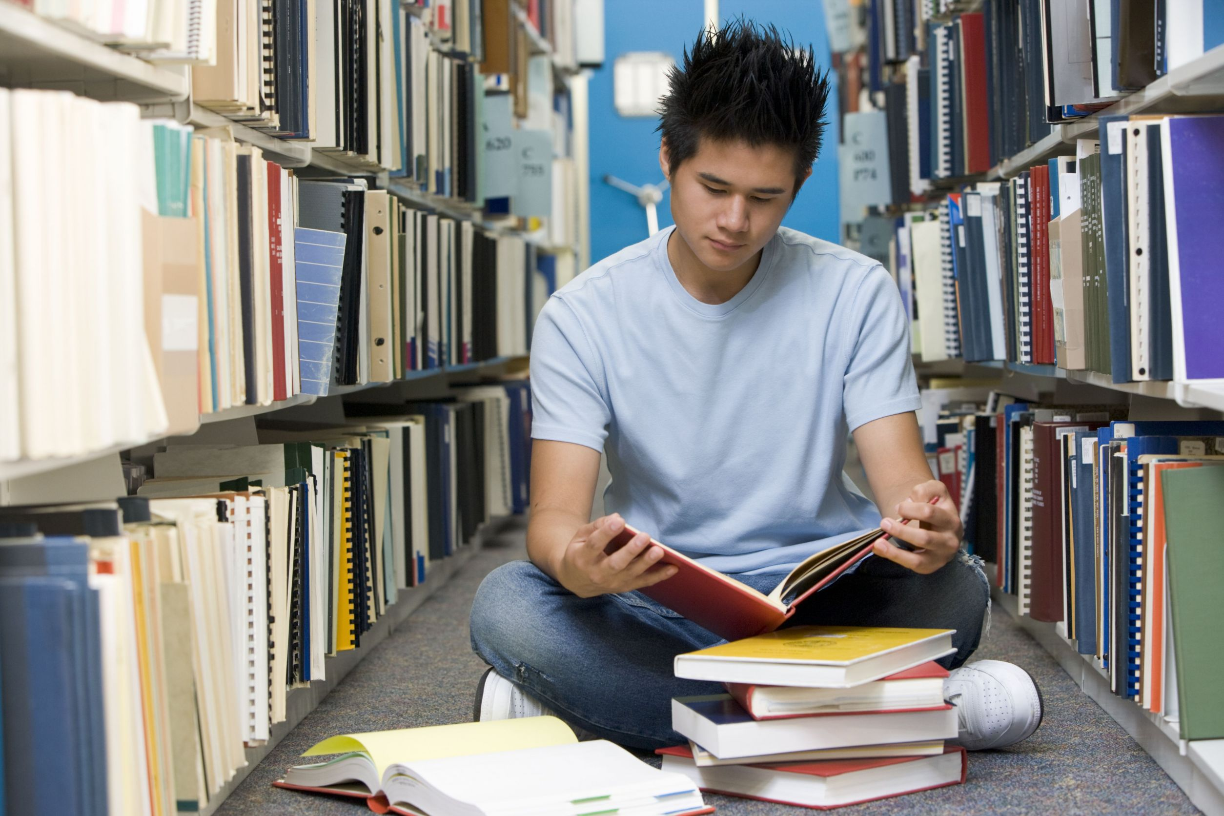 a man studying at a university library