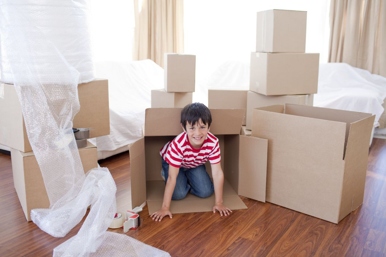 a boy moving into a new house
