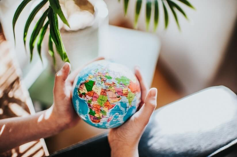 person holding a world globe map