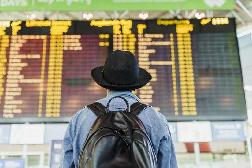 traveller looking at an airport timetable