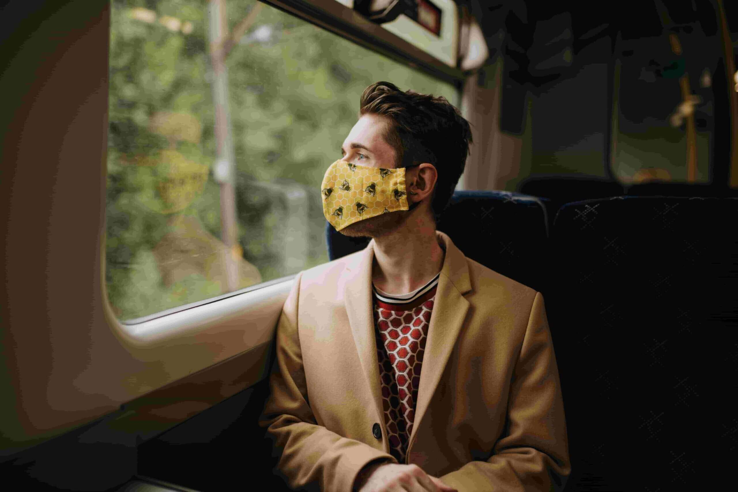 a man travelling with a face mask