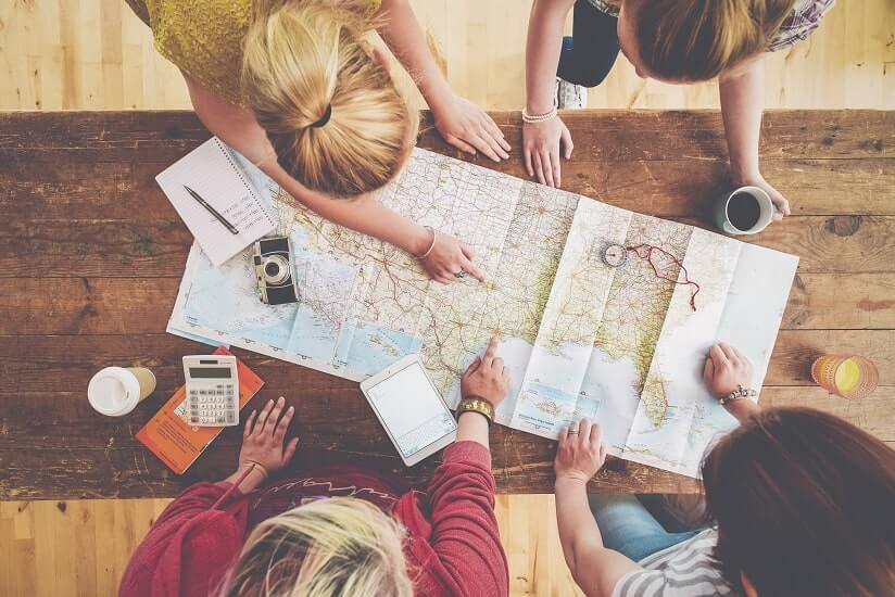 a group of friends exploring the map of the world