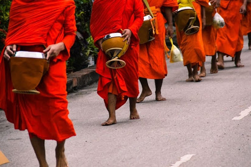 March in Laos, people dressed in red with drums