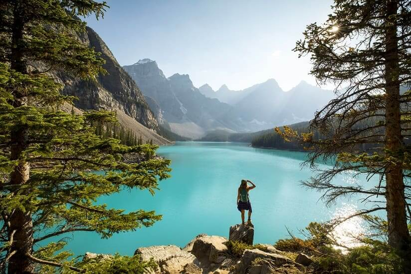 a tourist looking at a lake in Canada